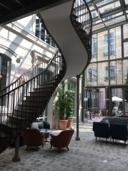 Amazing lobby with original stairs from the 18th century at the Hoxton Paris